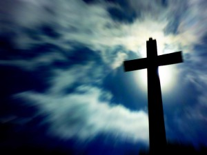 Cross of Jesus Christ with clouds and sun above